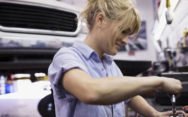 Fareham Car Garage - Lady fixing a car engine with blonde hair