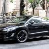 Fareham Car Garage - Shiny black Peugeot car parked on a street